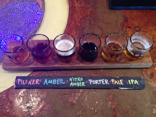 Stop 4: Fountain Square Brewing Co. repurposes paint stir sticks to label beer flights.