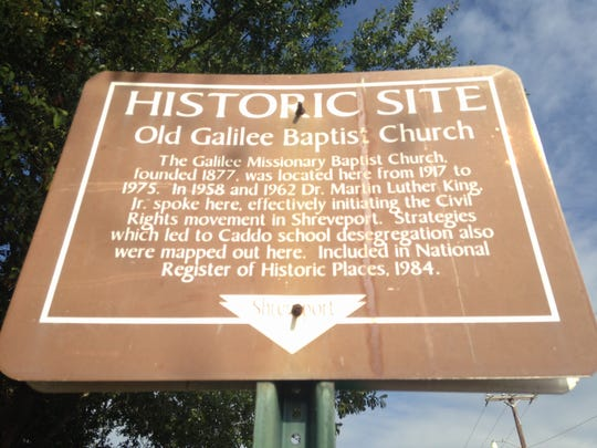 A historic site sign explains the significance of the old Galilee Baptist Church in Shreveport. The church was the location of the strategy meetings for school desegregation and also hosted Martin Luther King Jr.
