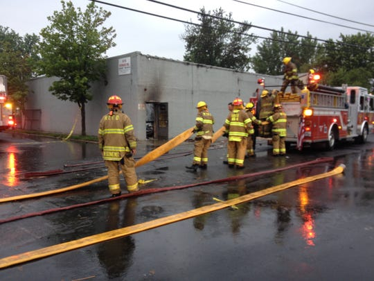 Firefighters at the scene of a fatal Union Beach fire early Monday.