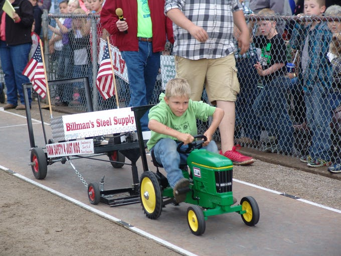 Brandon Karr, 6, of the Keene area competes in the Kiddie Tractor Pull.