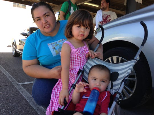 Sofia Avila, 29, protests for expedited immigration reform with her one-year-old son and three-year-old daughter.