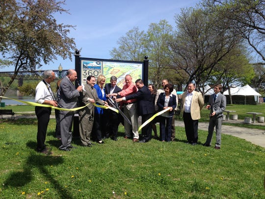 Local stakeholders gather in the City of Poughkeepsie to unveil a gateway sign at Victor C. Waryas Park.