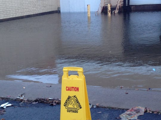 A flooded loading dock at the Medley Centre, the former mall, in Irondequoit.