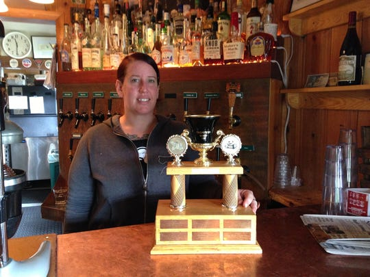 Jen Kent, brewer at Thompson Brewery and Public House, stands with the Barley Cup Trophy. The annual brewfest is happening this Saturday.