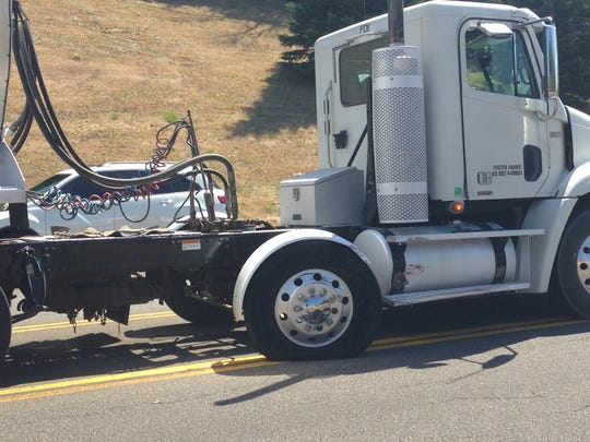 A semi truck which was hit by a Crysler 300 Wednesday afternoon, popping the tire of the truck and breaking the axle.