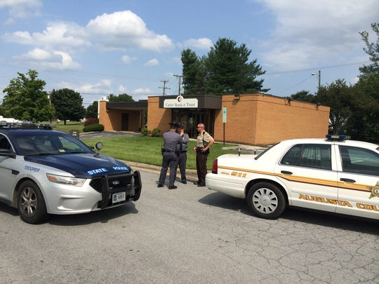 The State Police and Augusta County Sheriff's Office investigate a Tuesday bank robbery at Carter Bank and Trust in Weyers Cave.