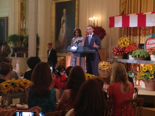 Jennifer Ganser snaps a photo of President Barack Obama and the First Lady Michelle Obama during Friday's event.