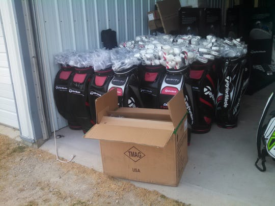 Golf clubs ready for customization at the U.S. Venture Open.