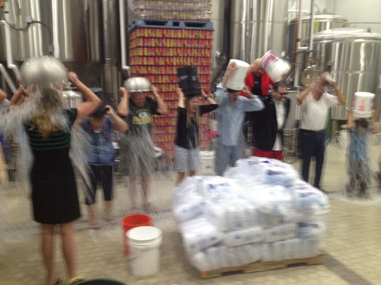 Community members got together for an ice bucket challenge this week at Bull Falls Brewery.