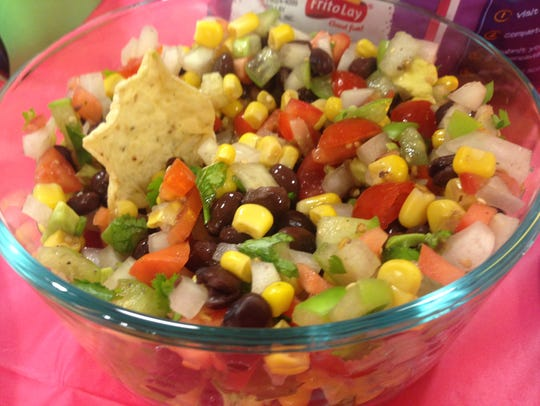 Cowboy Caviar includes a lot of vegetables to make it a slightly healthier tailgate food option.