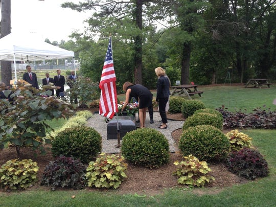 Members of the White Plains Common Council lay a wreath at the city's 9/11 monument during ceremonies Thursday morning in Liberty Park.