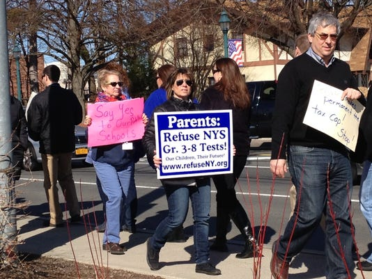 Protest outside state Sen. Carlucci's office - March 21, 2014