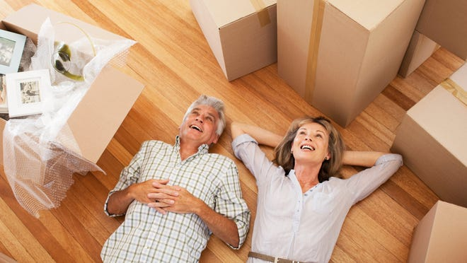 Senior couple surrounded by moving boxes.