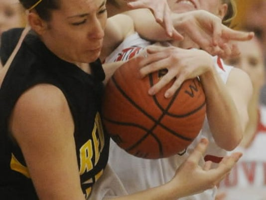 Kara Funk (in white with Dover) shown battling for the ball against Red Lion in January, 2011. GameTimePA.com file