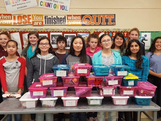 Jared Box Project student committee members from the Zia Middle School National Junior Honor Society stand with the boxes they made for sick children.