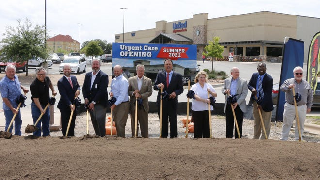 Hendrick Health System representatives and Brownwood city officials prepare to turn some dirt at the Urgent Care groundbreaking Monday afternoon.