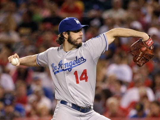 Los Angeles Dodgers starting pitcher Dan Haren throws against the Los Angeles Angels during the sixth inning of a baseball game on Wednesday, Aug. 6, 2014, in Anaheim, Calif. (AP Photo/Jae C. Hong)