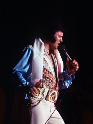 """Elvis Presley performs what would be his last Memphis concert July 5, 1976, before a crowd of 12,000 at Mid-South Coliseum. Exactly 22 years earlier, Elvis recorded """"That's All Right"""" at Sam Phillips' little studio at 706 Union. Introducing the song, he said: """"I've had some people say, 'Well, you can't do that song anymore.' Well, you, by God, just watch me."""""""
