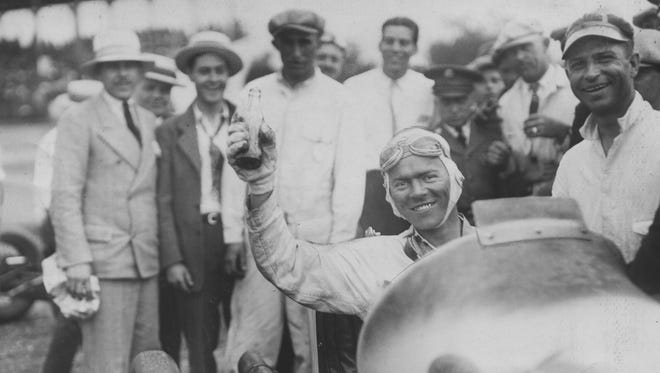 Frank Lockhart holds up a soft drink after winning the 1926 Indianapolis 500. Lockhart, a dirt-track racer from California filled in for owner/driver Pete Kreise who was ill with the flu.