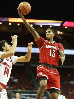 Ray Spalding drives to the basket with a finger roll shot during U of L's first scrimmage. Oct. 17, 2017.