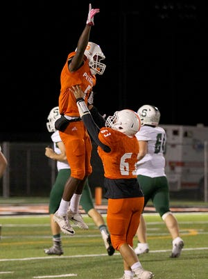 Jake Edgemon (left) celebrated a lot last season with Petrolia, catching 17 TD passes for the Pirates. Edgemon hopes to have a similar impact at a higher classification after he transferred to Rider for his senior season.
