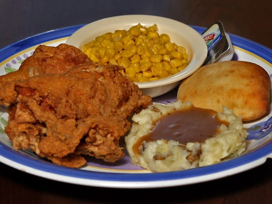 The broasted chicken with mashed potatoes, gravy, corn and a roll, served at the High Life Lounge