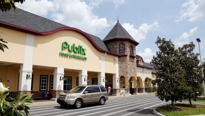FILE- In this Sunday, May 19, 2013 file photo, a vehicle passes the front of the Publix supermarket in Zephyrhills, Fla. Publix announced a change Tuesday, Feb. 6, 2018 in a reply on Twitter to Florida state Rep. Carlos Guillermo Smith. The Orlando-area Democrat had met with Publix officials Monday to discuss their refusal to cover Truvada for PrEP. The 6-year-old drug is more than 95 percent effective in preventing the contraction of human immunodeficiency virus, which can cause AIDS.(AP Photo/Scott Iskowitz, File)