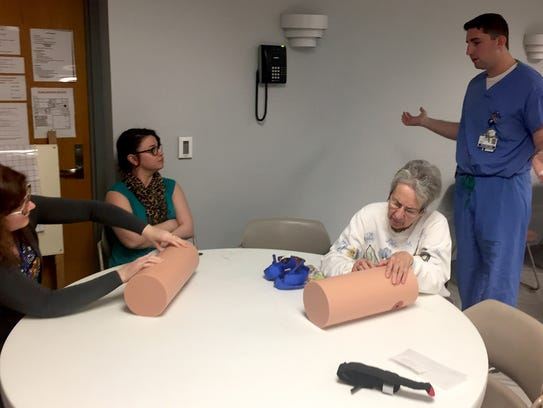 """Bianca Ruiz, of Spring Garden township, and Georgia Golden, of York City, eagerly applied themselves to packing a variety of bullet and stab wounds on a mannequin during the """"Stop the Bleed"""" event."""