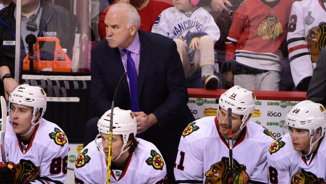 Chicago Blackhawks head coach Joel Quenneville watches during the third period against the Vancouver Canucks at Rogers Arena. The Blackhawks won 3-2.