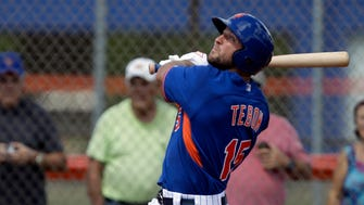 Tim Tebow hits a solo home run in his first at bat.