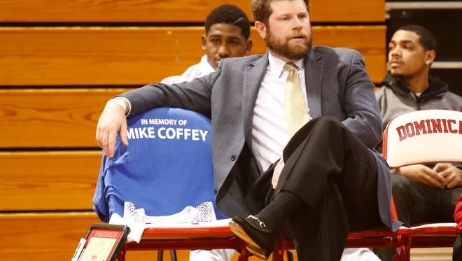 Dominican College assistant coach John Blackgrove sits next to a chair set up as a memorial to Michael Coffey, as Dominical College and Pearl River High School honor the 27-year-old who was a Pearl River graduate and Dominican College assistant basketball coach and assistant sports information director, at Dominican College in Orangeburg on Saturday, December 10, 2016.