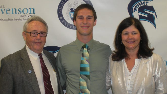 Mike Muffler is pictured with Stevenson principal James Gibbons and athletic director Lori Hyman.