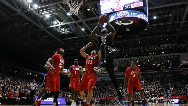 Cincinnati Bearcats center Coreontae DeBerry (22) takes it to the basket in the first half during the NCAA basketball game between the Southern Methodist Mustangs and the Cincinnati Bearcats, Sunday, March 6, 2016, at Fifth Third Arena in Cincinnati.