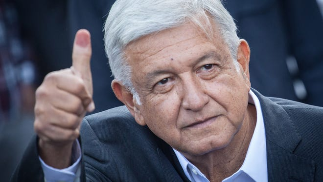 Presidential candidate Andres Manuel Lopez Obrador waves after voting in Mexico's presidential election on July 1, 2018, in Mexico City.