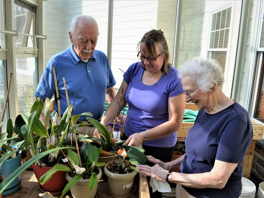 Karl Yochum, Becky Williams, and Doris Yochum provide some tender loving care to plants in the greenhouse at StoneRidge Poplar Run in Meyerstown. Regards,