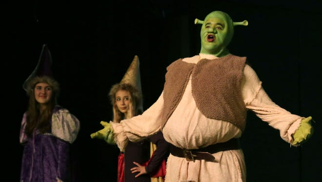 Martin Rawls performs the title character of Shrek The Musical Jr. during a rehearsal for the Mansfield Playhouse, which will premiere this weekend.