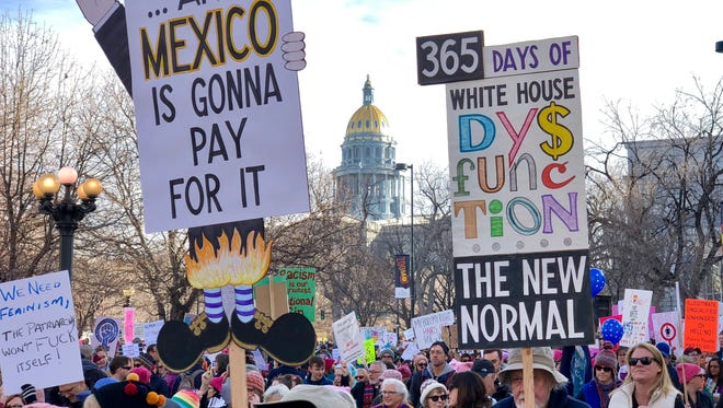 Tens of thousands sign-carrying of protestors filled Denver's Civic Center Park on Saturday, Jan. 20, 2018, for a women's march and rally.