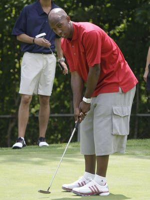 Detroit Piston Chauncey Billups tries a putt during his charity golf outing at the Birmingham Country Club on July 28, 2008.