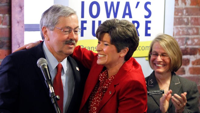 Republican U.S. Senate nominee Joni Ernst hugs Gov. Terry Branstad during a GOP campaign event at Smokey Row in Oskaloosa on Wednesday, June 4, 2014.  At rear is Congressional candidate Mariannette Miller-Meeks.