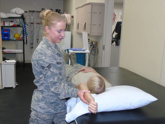 Senior Airman Kaitlyn Callahan does physical therapy