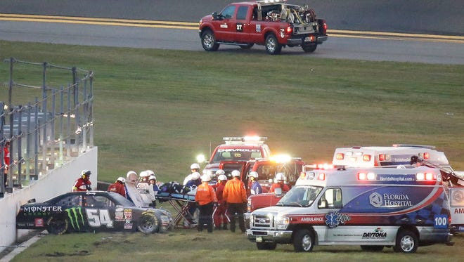 Kyle Busch (center) is taken to an ambulance on a stretcher after he was involved in a multi-car crash Saturday during the Xfinity Series race at Daytona International Speedway.