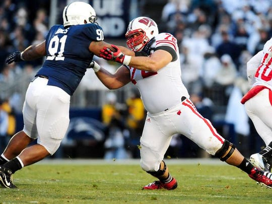 November 24, 2012; University Park, PA, USA; Wisconsin Badgers offensive lineman Travis Frederick (72) blocks Penn State Nittany Lions defensive tackle DaQuan Jones (91) at Beaver Stadium. Mandatory Credit: Evan Habeeb-USA TODAY Sports
