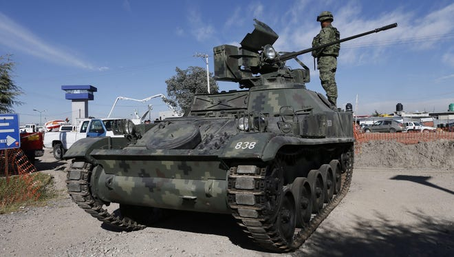 Federal agents and members of the Mexican Army with an armored vehicle patrol outside the high security prison Altiplano where Mexican drug trafficker Joaquin 'El Chapo' Guzman, is detained in the city of Almolaya de Juarez, Mexico, 09 January 2016. 'El Chapo' Guzman was arrested on last 08 January. General Attorney of Mexico Arely Gomez said one of the reasons that facilitated the capture of Guzman was his recent contacts with producers and other personalities of the cinema industry to make a movie.