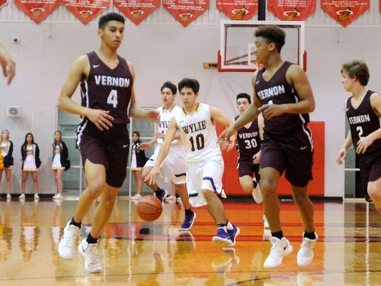 Wylie guard Steven Lopez (10) brings the ball down the court during the Bulldogs' 91-43 win against Vernon in the Region I-4A bi-district playoff in Olney on Monday, Feb. 19, 2018.