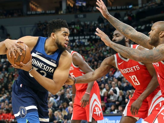 Minnesota Timberwolves' Karl-Anthony Towns, left, is
