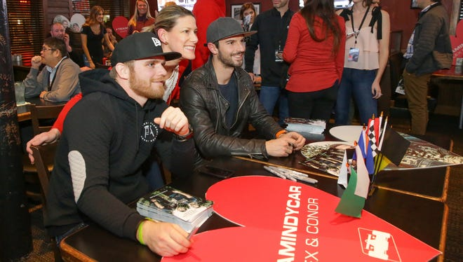 "IndyCar fan Cathy Adler, center, poses with Conor Daly, left, and Alexander Rossi at the Feb. 14 ""Amazing Race"" watch party at Kilroy's Bar & Grill."