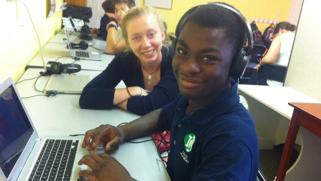 Nations Ministry Center's after-school program helps refugee students with homework and English skills.