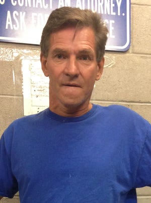 Joseph Wasylk, 55, was arrested Monday on suspicion of indecent exposure after police say he urinated on a wall outside Peoria police headquarters.