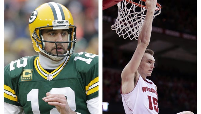 When asked by a Twitter follower which player on the University of Wisconsin men's basketball team he'd like to play against, Green Bay Packers quarterback Aaron Rodgers (left) chose Badgers standout Sam Dekker.