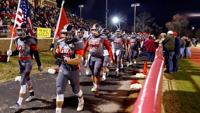 Columbia AcademyÕs Timmy Riley (3) and Tre Davidson (24) lead their team past fans before their game against Union City, Friday, Nov. 24, 2017, in Columbia, Tenn.
